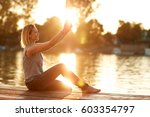 young smiling female making... | Shutterstock . vector #603354797