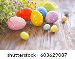 easter eggs and spring flowers... | Shutterstock . vector #603629087