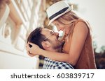 happy young couple hugging and... | Shutterstock . vector #603839717