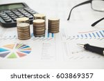 row of coins calculator with... | Shutterstock . vector #603869357