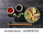 gyozas potstickers on lettuce...   Shutterstock . vector #603898703