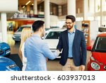 young couple shaking hands... | Shutterstock . vector #603937013
