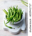 green beans in white bowl on... | Shutterstock . vector #603941717
