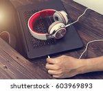 headphones with listening music.... | Shutterstock . vector #603969893