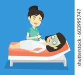 cosmetologist applying cosmetic ... | Shutterstock .eps vector #603995747