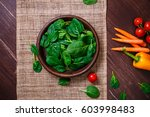 spinach leaves in bowl. carrot  ... | Shutterstock . vector #603998483