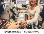 beautiful young cashier is...   Shutterstock . vector #604007993