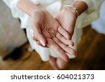 hands of bride holds engagement ... | Shutterstock . vector #604021373