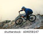 enduro cyclist riding the... | Shutterstock . vector #604058147