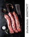 fresh raw pork tenderloin on... | Shutterstock . vector #604079477