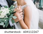 close up of groom's hand... | Shutterstock . vector #604112267