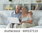 elderly couple with a laptop | Shutterstock . vector #604137113