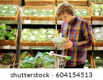 young man buying vegetables at...   Shutterstock . vector #604154513