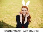 portrait of a young smiling red ... | Shutterstock . vector #604187843