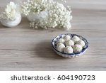 white vase and flowers in... | Shutterstock . vector #604190723