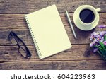 notebook coffee cup and pen... | Shutterstock . vector #604223963