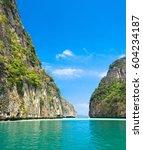 sea rocks lagoon mountains  | Shutterstock . vector #604234187