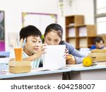 asian elementary schoolgirl and ... | Shutterstock . vector #604258007