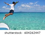 Man Jumps Into The Sea On His...