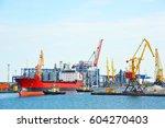 tugboat assisting bulk cargo... | Shutterstock . vector #604270403