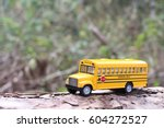 school bus with tree trunk and... | Shutterstock . vector #604272527