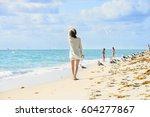 miami beach  peaple are walking....   Shutterstock . vector #604277867