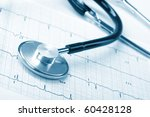 stethoscope on the cardiogram | Shutterstock . vector #60428128