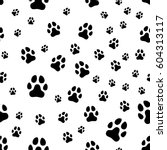 paw print seamless. traces of... | Shutterstock . vector #604313117