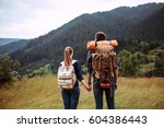 a couple hikers hiking with... | Shutterstock . vector #604386443