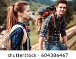 a couple of tourists sitting on ... | Shutterstock . vector #604386467