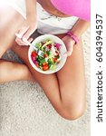 young woman eating healthy... | Shutterstock . vector #604394537