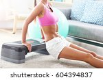 sporty woman using step...   Shutterstock . vector #604394837