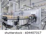 conveyor belt in motion at... | Shutterstock . vector #604407317