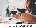 romantic couple enjoying dinner ... | Shutterstock . vector #604419347