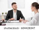 young woman at notary public... | Shutterstock . vector #604428347