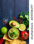 guacamole bowl with ingredients ... | Shutterstock . vector #604548197