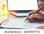 close up businessman hand... | Shutterstock . vector #604554773