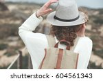 adventure woman with curly... | Shutterstock . vector #604561343