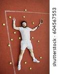 tennis fail  tired man laying...   Shutterstock . vector #604567553