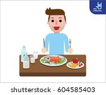 happy young man eating healthy... | Shutterstock .eps vector #604585403