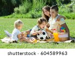 happy young family of four... | Shutterstock . vector #604589963