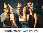 friends having fun at birthday... | Shutterstock . vector #604590497