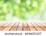 empty wooden table with blurred ...   Shutterstock . vector #604602107