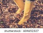 yellow boots walk in the dead... | Shutterstock . vector #604652327