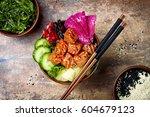 hawaiian salmon poke bowl with... | Shutterstock . vector #604679123
