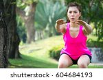 asian woman warm up to exercise ... | Shutterstock . vector #604684193