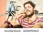 happy hipster couple taking... | Shutterstock . vector #604690463
