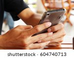 close up hands using mobile... | Shutterstock . vector #604740713