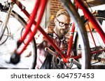 a man working in a bicycle... | Shutterstock . vector #604757453