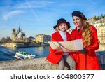 bright in paris. stylish mother ...   Shutterstock . vector #604800377